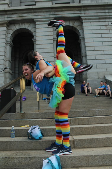 Billie Pellerito holds Kellie Martin on her back after the Pride 5k on June 16.