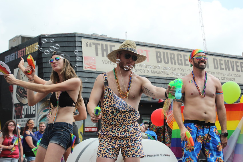 Pride Parade participants sprayed water guns and bubbles onto crowds from a float on June 17.