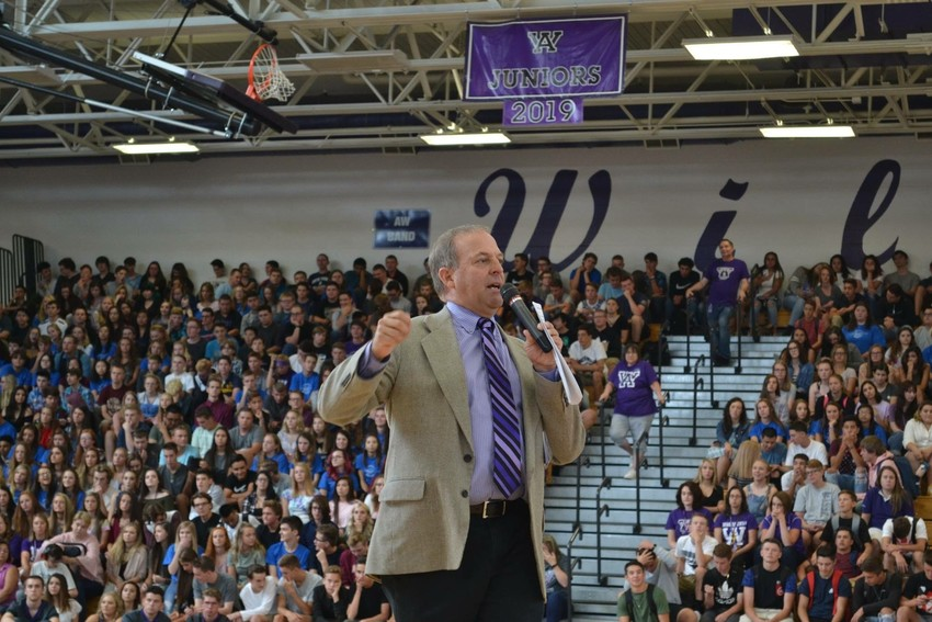 A-West principal Dr. Robert Bishop speaks at an assembly kicking off the 2017-18 school year, his last year as principal.