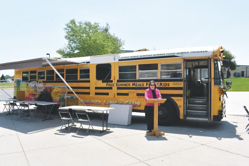 Beth Wallace, executive director of Jeffco Food and Nutrition Services, speaks in front of the mobile cafe at the Summer Food Service Program kickoff event.
