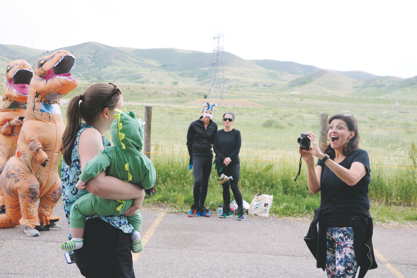 It's picture time at Dinosaur Ridge's Guinness World Record attempt. About 41 people of all ages attended dressed as various dinosaurs.