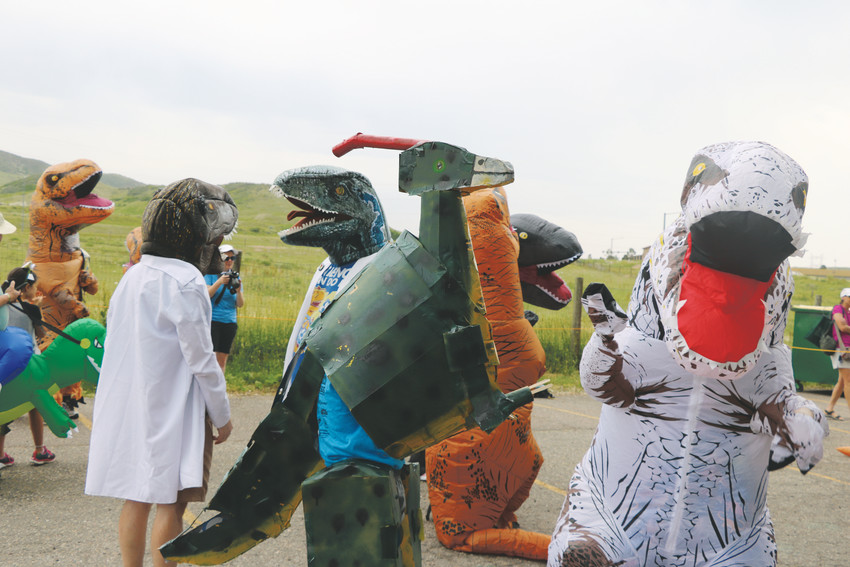Some of the dinosaur costumes attendees wore to Dinosaur Ridge's Guinness World Record attempt on June 16.