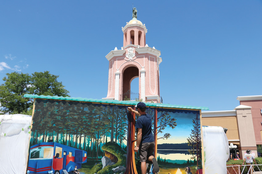"Wyoming artist Dan Toro works on his mural in the Lamar Station Plaza during the third annual MuralFest last August in front of Casa Bonita in Lakewood. ""I think this event is great — I had no idea all this was going on,"" Toro said. ""This is all beautiful."""