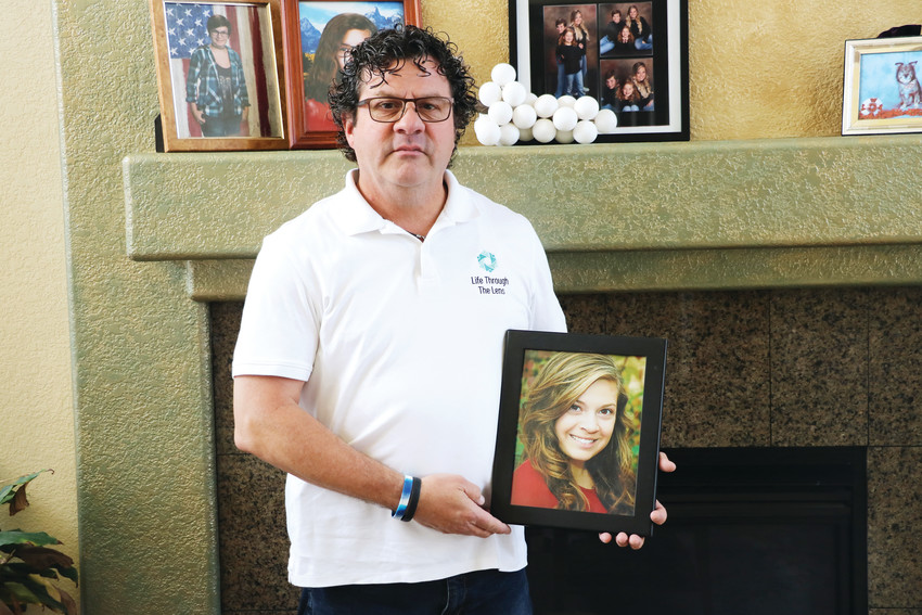 "Standing in his Parker home, Johnnie Medina holds a photo of his daughter, Mikayla, who was 24 years old when she died by suicide nearly a year ago. ""You don't really move forward,"" he said. ""You just exist."""