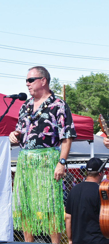 Arvada Mayor Marc Williams, clad in Hawaiian clothing, addresses the crowd at Sand in the City.