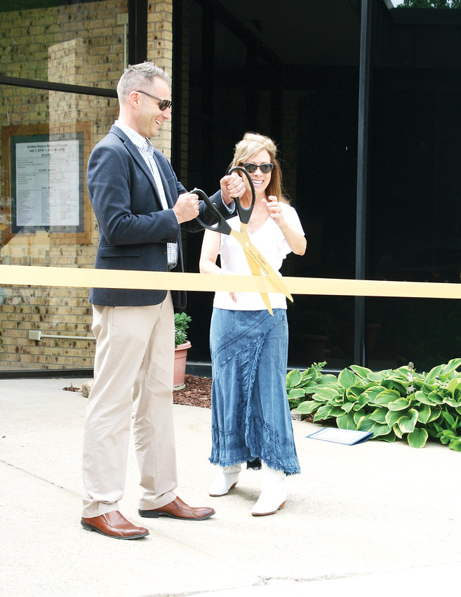 Nathan Richie, director of the Golden History Museum, and Leslie Klane, the Golden Chamber of Commerce's president/CEO, celebrate the history museum's grand reopening with a ribbon cutting on June 23.