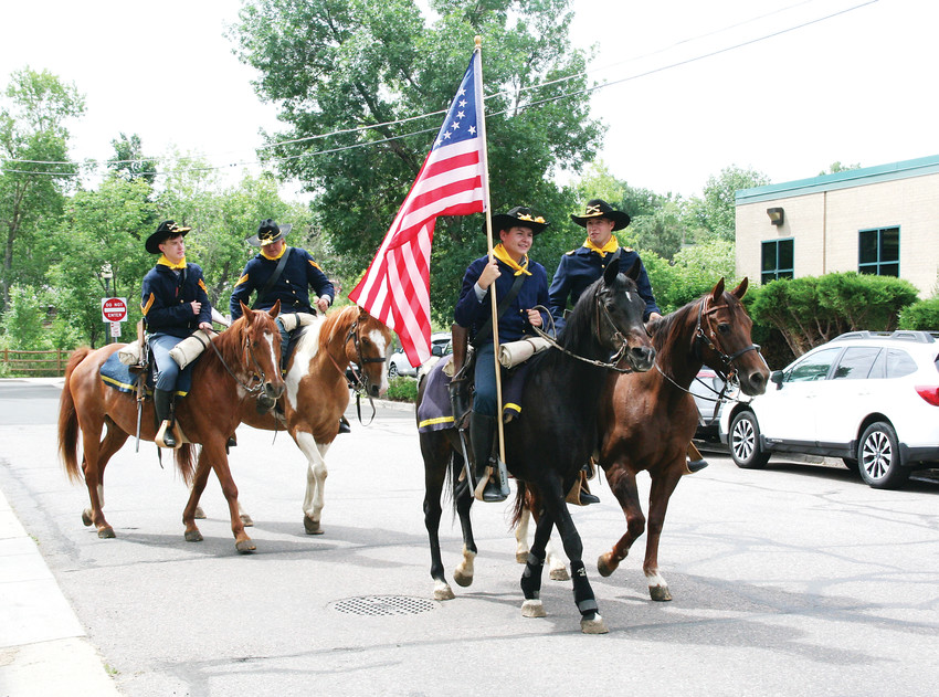 The Westernaires' Cavalry Team rides off following a special appearance at the Golden History Museum's grand reopening on June 23.