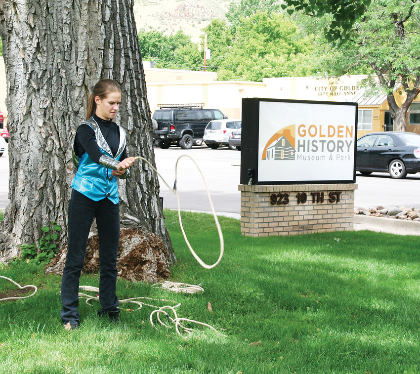 Amanda Cook, 17, of Evergreen performs tricks with her lasso in front of the Golden History Museum on June 23 as part of the museum's grand reopening events.