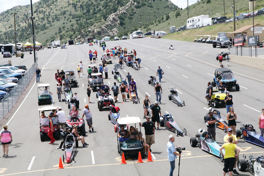 Crews in their golf carts and drivers in their cars sit in the staging lanes awaiting their turns at the starting line during the June 23 sessions of the Division 5 Junior Dragster Championship races at Bandimere Speedway. The 121 entries from Colorado and surrounding states were driven by drivers ranging in age from five to 17.