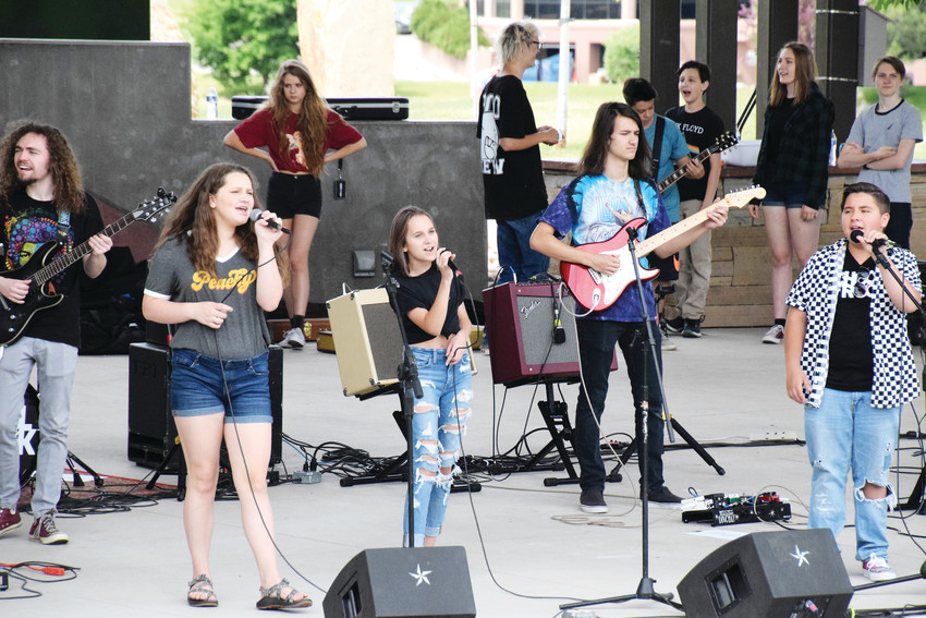 A group from the School of Rock Aurora perform on stage June 23 at the Picnic in the Park event at Centennial Center Park. Performers from dance troupe Mile-High Stars Athletics and the Margarita Brothers Band also performed.