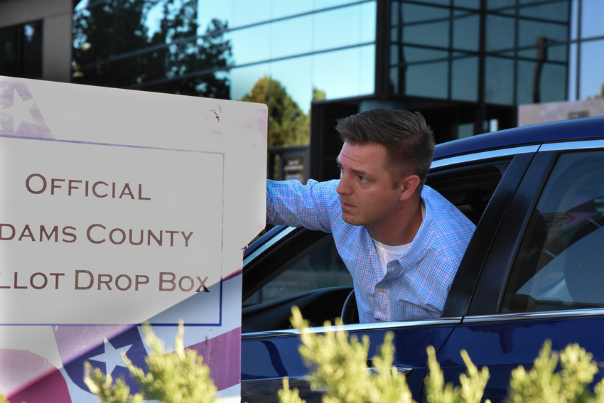 Clint Mickel of Westminster, drops off his primary ballot at the Adams County Economic Development Vote Center in Westminster, on Colorado Primary Election Day, June 26. The service centers, including the Thornton Civic Center and the Westminster Motor Vehicle office as well as numerous drop-off locations throughout the state, will accept ballots until 7 p.m. Tuesday.