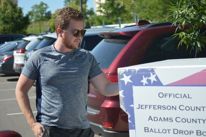 Thomas Cooke of Westminster drops off his primary ballot at the ballot box located in the parking lot in front of Westminster's Police Station Tuesday morning, June 26. Voters can drop off their ballots at one the 21 boxes or get help at one the seven voter support centers until 7 p.m.