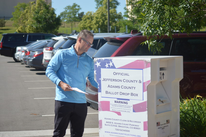 Charles Prather of Westminster drops off his primary ballot at the ballot box located in the parking lot in front of Westminster's Police Station Tuesday morning, June 26. Voters can drop off their ballots at one the 21 boxes or get help at one the seven voter support centers until 7 p.m.