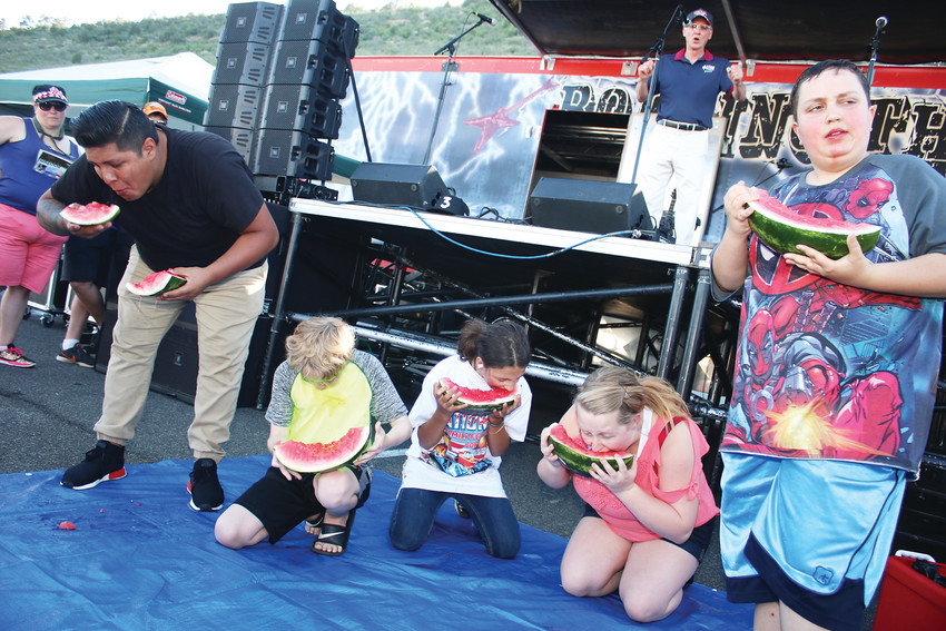 Participants compete in a watermelon eating contest as part of Bandimere Speedway's annual Jet Car Nationals and Family Festival, which features a full day of special events and culminates in fireworks.