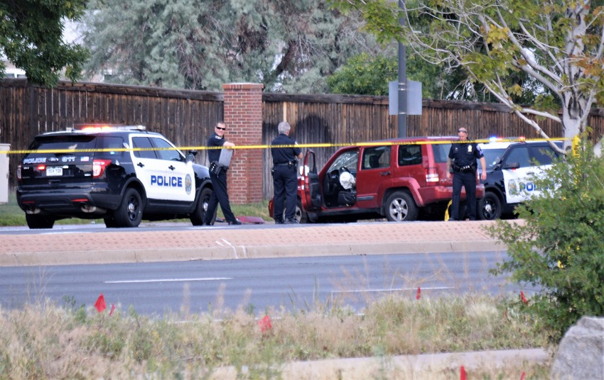 Police cluster around a maroon Jeep SUV involved in an alleged burglary on the afternoon of June 26 at 103rd and Dover. The driver of the vehicle fled officers there and made his way to about 92nd and Fenton, where he was shot by a motorcycle officer. Police said 92nd would be closed for hours Tuesday night.