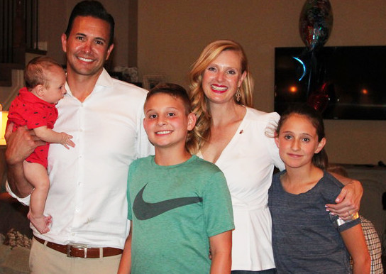 Abe Laydon pictures with his wife, Kim, and three children, Bolden, Thane and Ava, at a watch party on June 26.