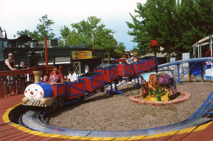 A couple of families enjoy a kiddie train ride at Heritage Amusement Park in July 2011. Alan Bader opened the amusement park in 1999 with four kiddie rides and expanded it to include more than 20 attractions by its closing date of June 30.