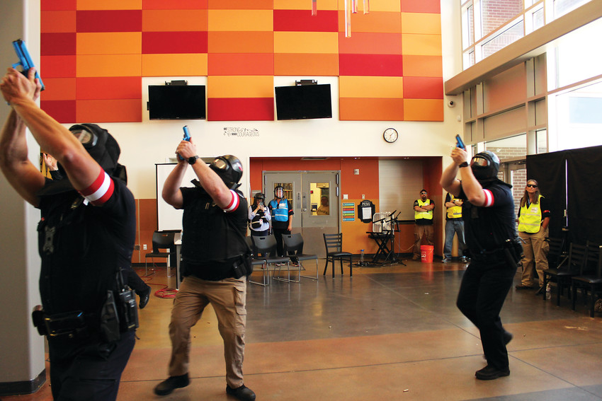 Police come into the building for the active shooter drill with Denver Public Schools.