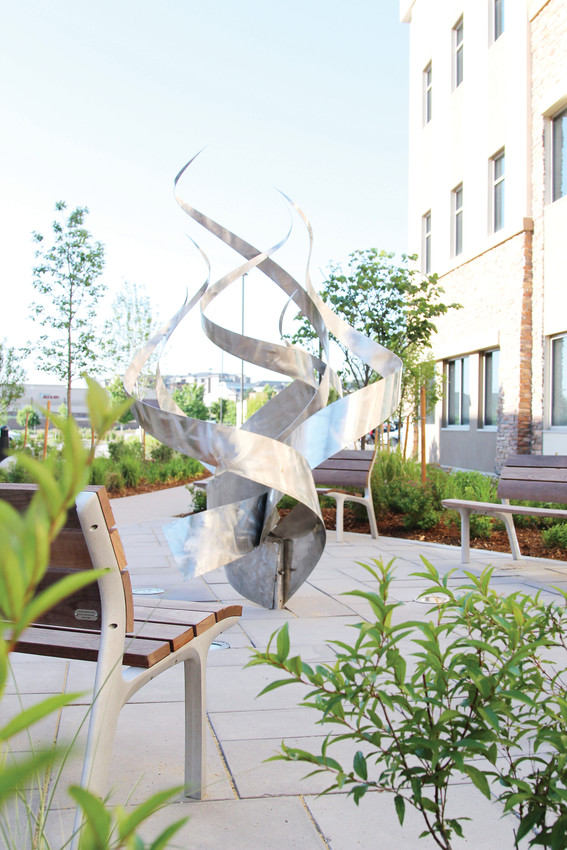 Public artwork is intermingled with blooming plants and landscaping at Castle Rock Adventist's Healing Garden