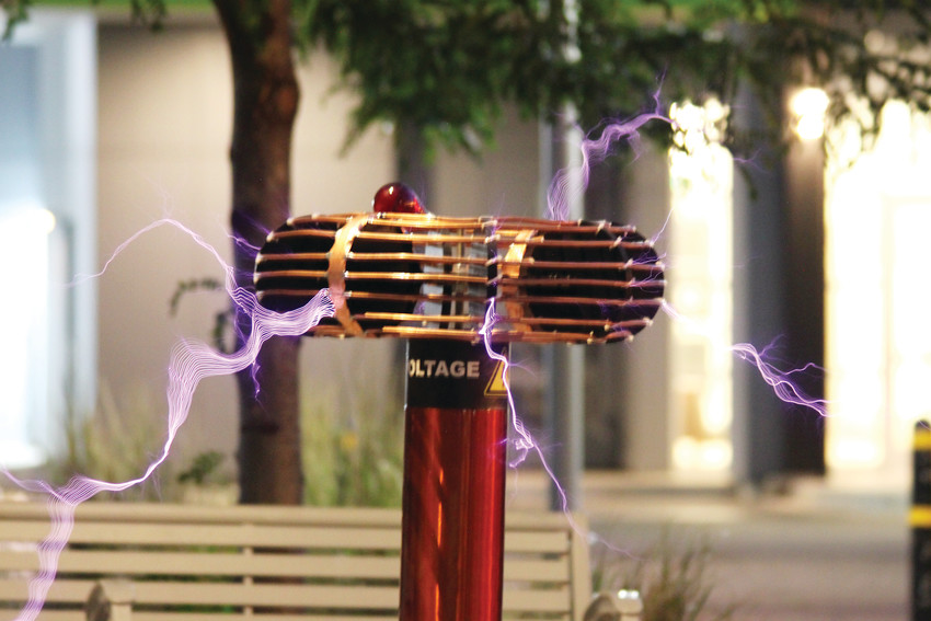 Upward of 400,000 volts fly from Matt Crabtree's homemade Tesla coil during a demonstration outside the Brew on Broadway on June 25.