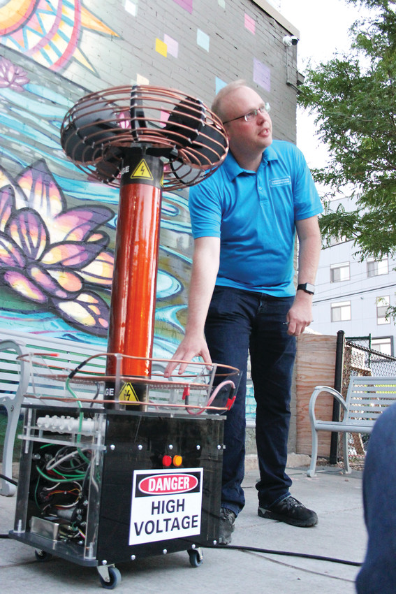 Matt Crabtree, president of the Englewood Historic Preservation Society, explains the workings of his homemade Tesla coil, a device that transmits electricity through the air.