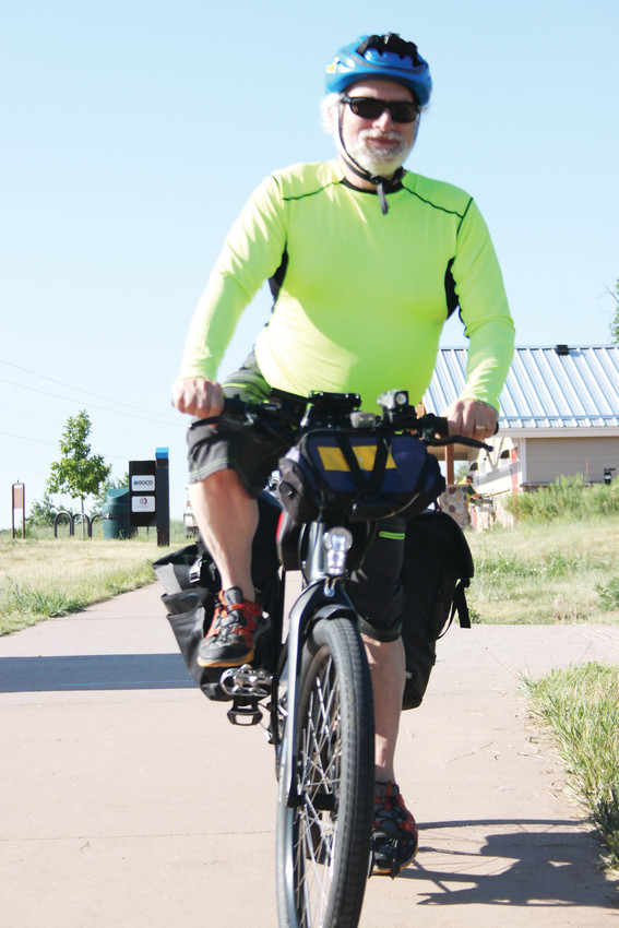 Keith Bierman sets out to complete his commute to work at CenturyLink after stopping for a burrito.