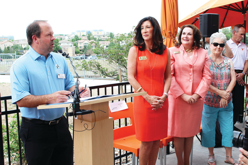 Scott LaBrash, chair of South Suburban Parks and Recreation Department's board of directors, speaks during the ribbon cutting ceremony for the Lone Tree Leaf Pedestrian Bridge June 28 at Snooze restaurant. Right of LaBrash is Lone Tree Mayor Jackie Millet.
