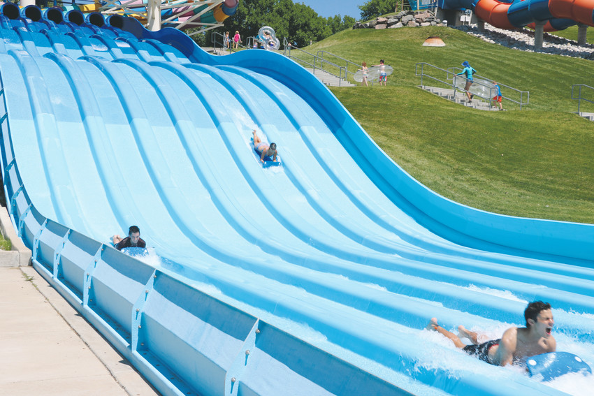 Riders race each other at Water World.
