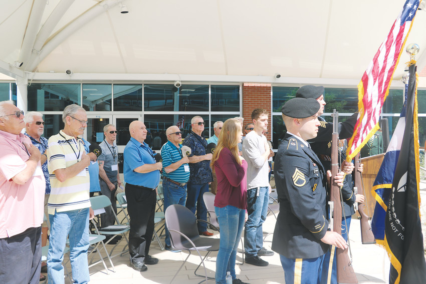 Members of the Jeffeson County Platoon stand for the national anthem and posting of the colors during a reunion event for the veterans on June 30.