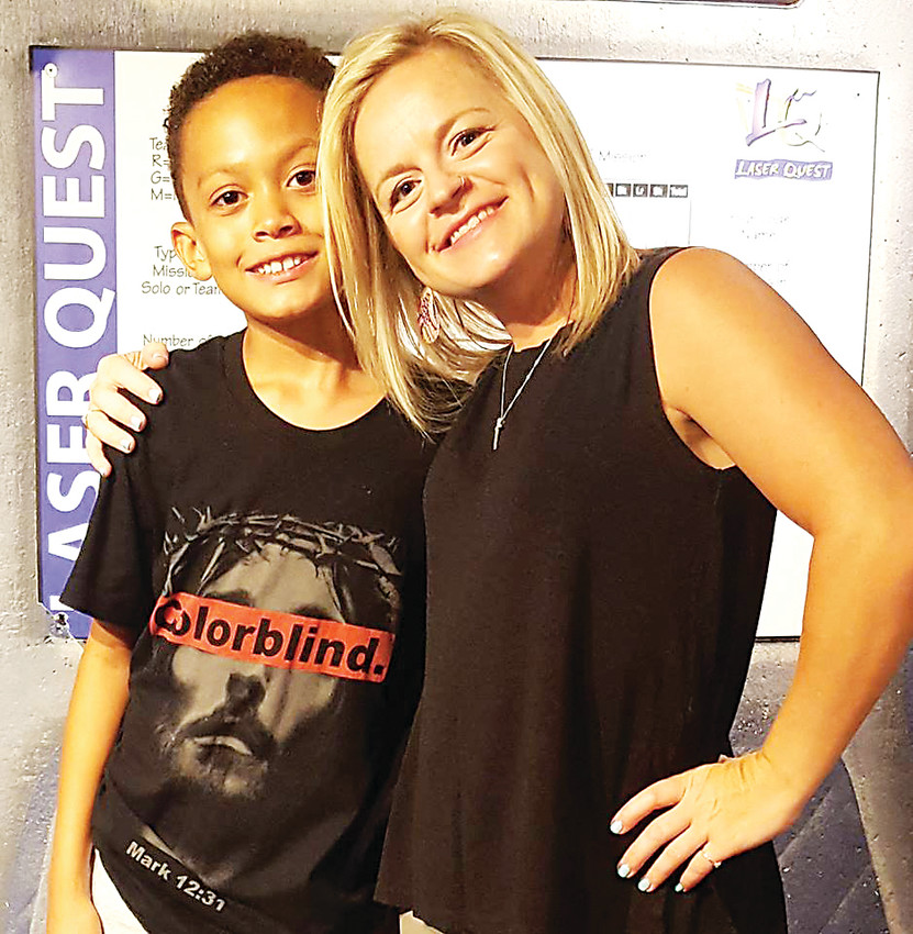 Dru Connolly, fitness coordinator at the Highlands Ranch Community Association, stands with her son, VJ. Connolly was born and raised in the community.