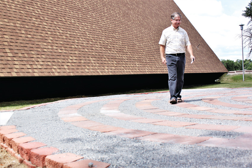 Advent Lutheran church member Tom LaRose walks the meditative labyrinth recently installed at the church in Westminster. Labyrinths have been used for centuries for meditation and contemplation.