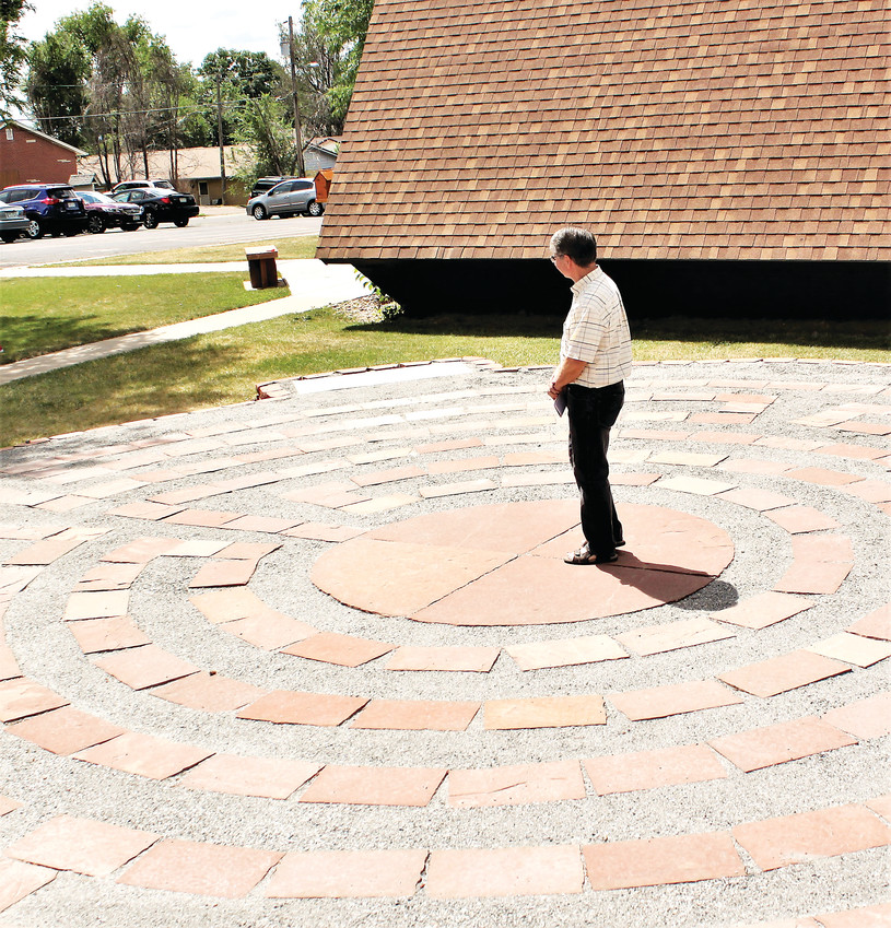 Advent Lutheran church member Tom LaRose contemplates the center of the seven-circuit labyrinth outside the church. The labyrinth was relocated from the Loreto convent and was placed by church members June 10.