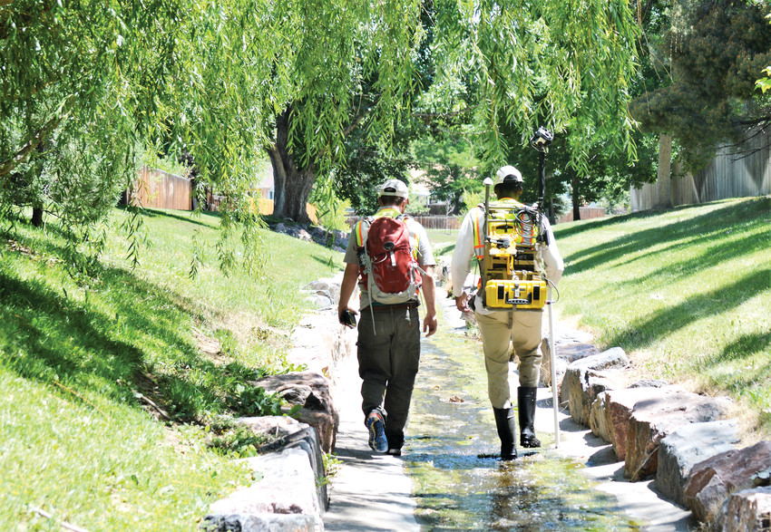 Duke Douglas and Colin Barry walk along the middle of the Ketner Tributary, a drainage that begins at 102nd and Oak Street. The two will walk all of the similar drainages and canals in the city this July, part of a city of Westminster water quality monitoring project.