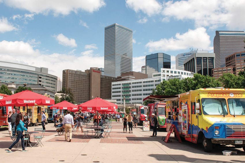 Food trucks line Civic Center Park in June in Denver for Civic Center EATS as the lunchtime crowd begins to file in. Now on its 13th year, Civic Center EATS hosts approximately 25 food trucks each day on Tuesdays, Wednesdays and Thursdays from May 1 through Oct. 4.