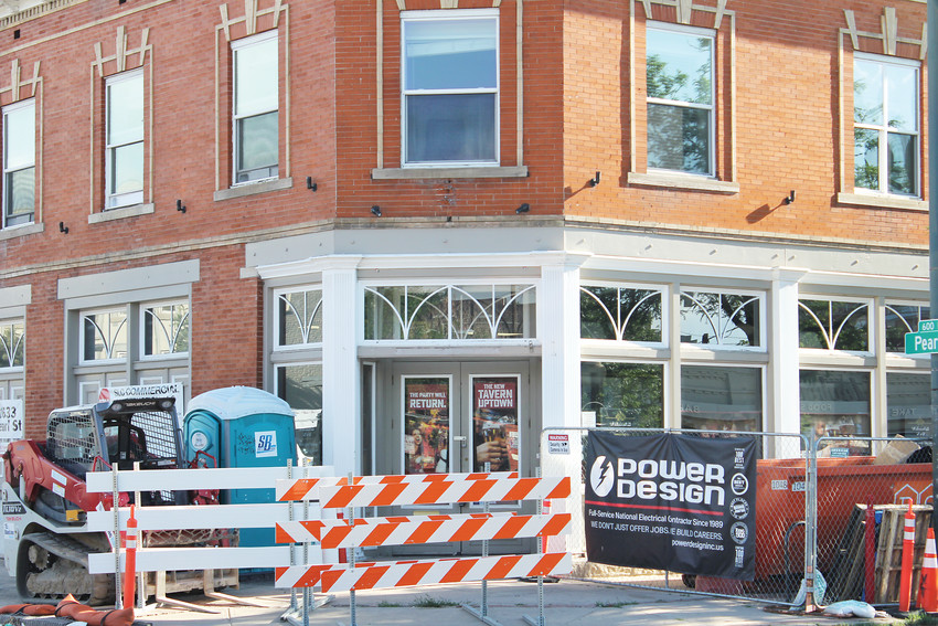 Tavern Uptown on East 17th Avenue is closed while an adjacent apartment building is under construction.