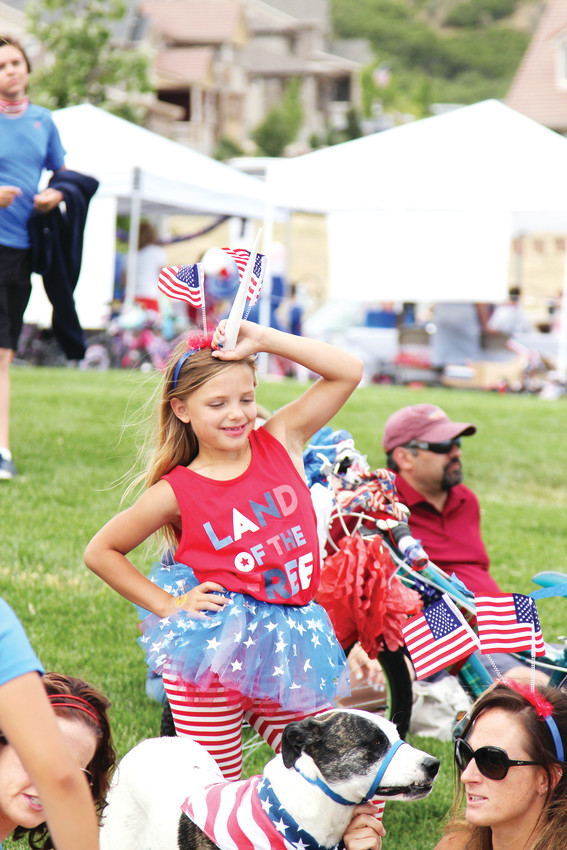 Julia Dern, 8, attended The Meadows Fourth of July community event with her mother, Melissa.