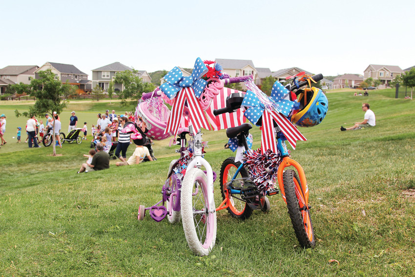 Children decked out their bicycles in their best Fourth of July decor for a parade and festival in The Meadows on July 4.