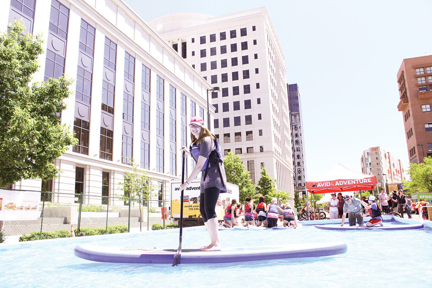 Denver-resident Emily Henkelman tried stand-up paddle boarding in the adventure section of the People's Fair on June 2.