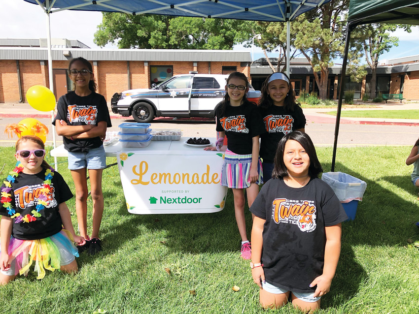 Five students — all 9 years old — of Mark Twain Elementary School at their lemonade stand at the school June 23. Left to right: Kendall Sova, Jadyn Harris, Tessa Trinder, Taia Brown and Gabby Fuentes (front right).