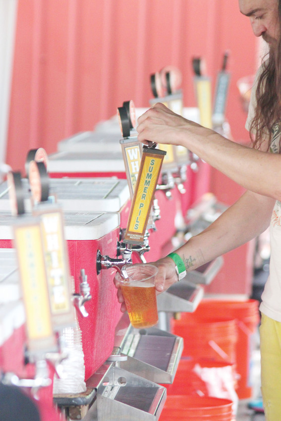 Breckenridge Brewery bartender Jared Wolf serves up brews from cooler taps in one of many beer tents.