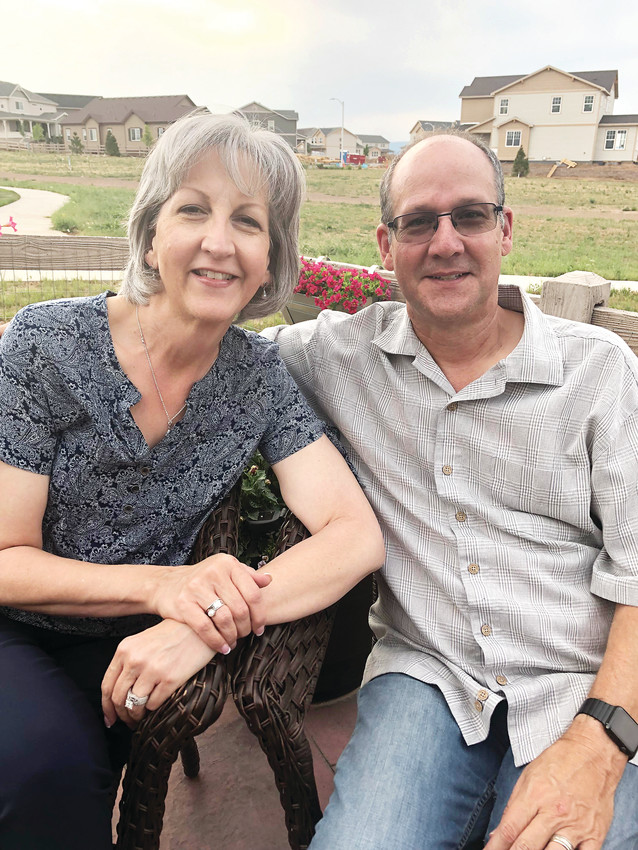 "Dave and Leslie Samson, the 29th homeowners in Sterling Ranch, sit in the backyard of their one-story house. Both widowed, the Samsons married five years ago and wanted to buy a place of their own. ""We get to enjoy it and we know there is not another move in our future,"" said Leslie Samson."