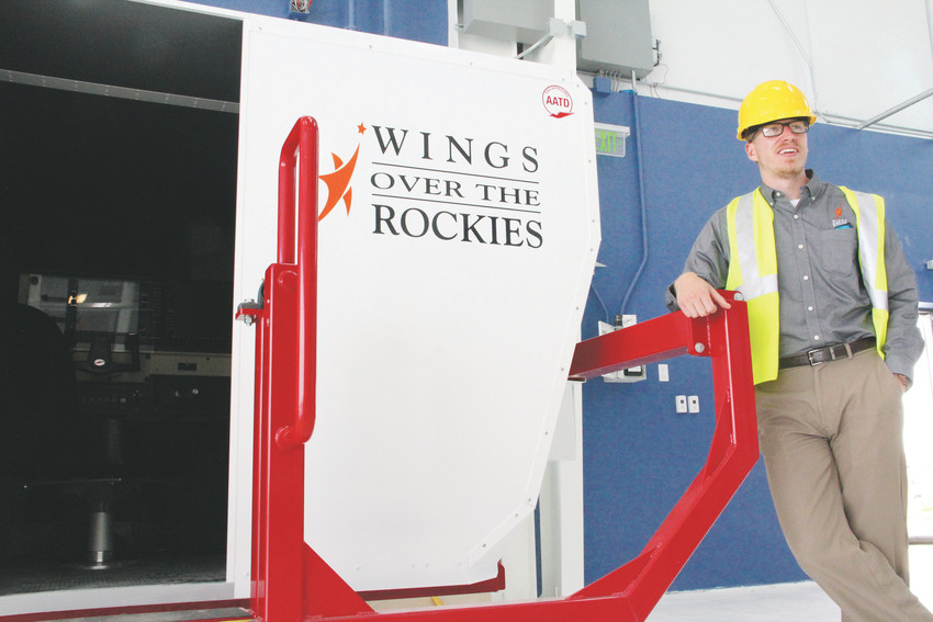Ben Theune, director of marketing for the nonprofit Wings Over the Rockies, stands at a flight simulator at the Boeing Blue Sky Aviation Gallery July 5. The facility will be the first phase to open of the nonprofit's Exploration of Flight campus at Centennial Airport.