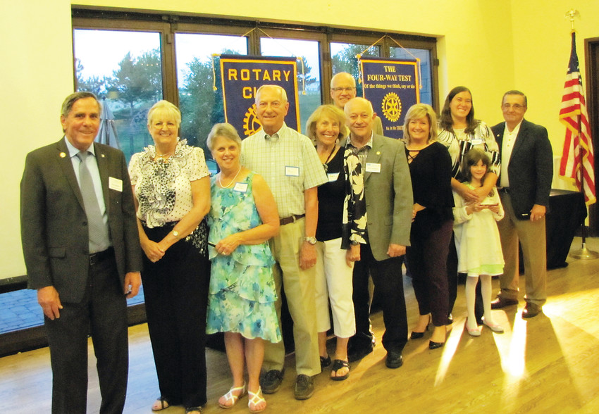 The new board of directors for the Rotary Club of Parker. From left, Ken Claiborne, president; Kam Breitenbach, public relations; Jan Beller, secretary; Ron Beller, treasurer; De Olson and Ron Satiajin, Sgts. at Arms; Steve Brown, grants; Peggy Carter, vocational; Katie and Becca Kendrick, representing Patrick Kendrick, club service; Carl Finamore, Rotary Club of Parker president.