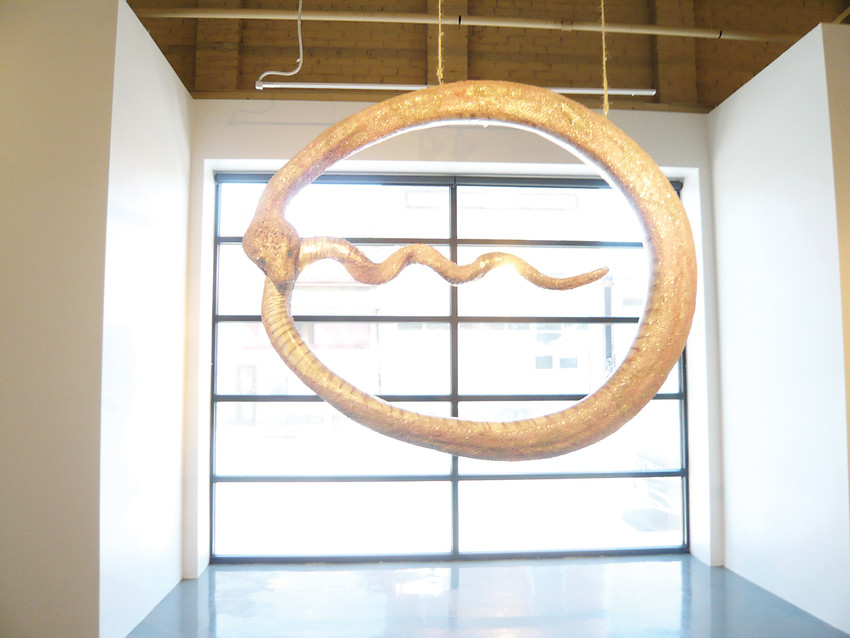 """Ouroborous,"" by Emma Hardy and Rebecca DiDomenico, a legendary snake that represents an ancient symbol, hangs at the entrance to ""Pink Progression"" exhibit at CVA."
