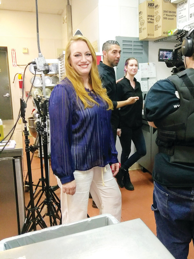 "Parker resident Michelle Ullman films an episode of her series, ""On the Menu with Michelle Ullman,"" at Castle Rock's 212 Pizza."