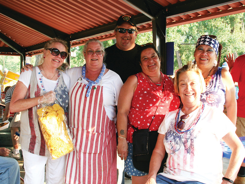 Members of Golden's American Legion Post 21 gather for a quick photo between feeding the thousands of attendees at the Golden Lions' Fourth of July celebration.