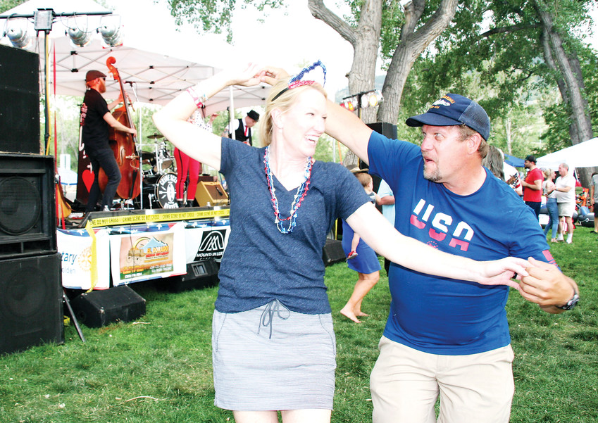 Sarah Martin of Denver and Bob Sobchak of Westminster were just two of many who put their dancing shoes on during Kerry Pastine and the Crime Scene's set at this year's Fourth of July celebration.