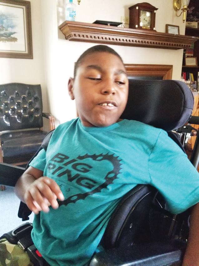Noah Williams, 9, of Georgia proudly wears his Big Ring Cycles T-shirt as he prepares for a Big Cycling Adventure that he will travel to Colorado for this August. Williams has cerebral palsy and he will be accompanying Goldenite Helen Gardner on a multiday, 158-mile bicycle ride on the West Elk Loop Scenic Byway located near Crested Butte and Gunnison.