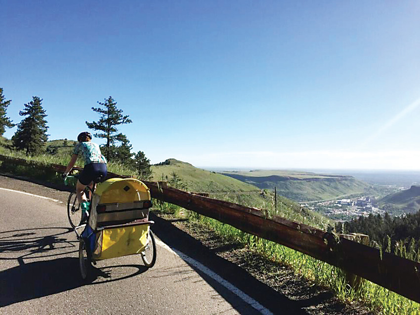 Helen Gardner trains on Lookout Mountain with an empty trailer. On July 15, the community is invited to join her on a training ride in Golden when she will be pulling PJ Snyder, 32, a local man who has Angelman Syndrome who offered to help her train.
