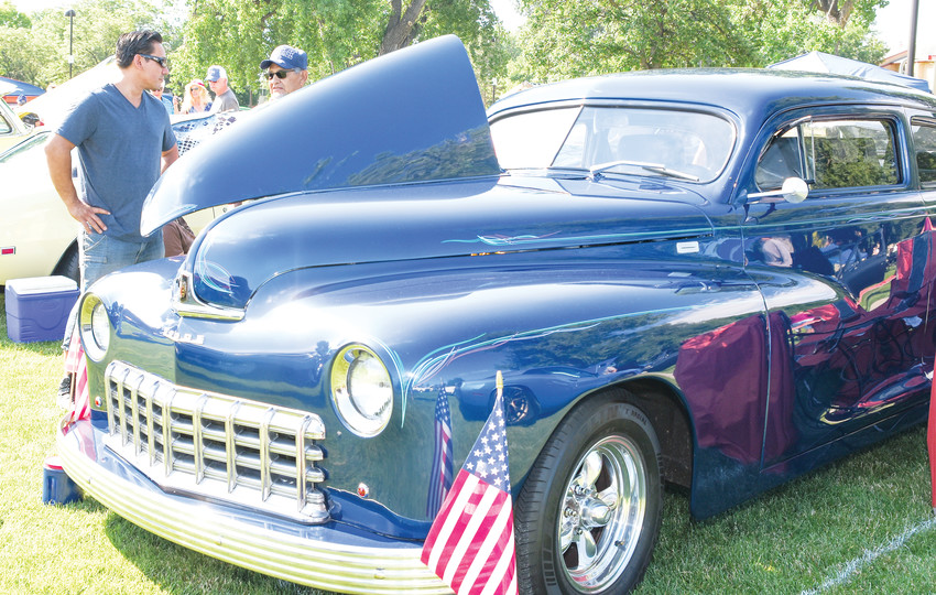 Tom Cardenas of Northglenn, right, talks with Peter Lacrue of Denver, behind Cardenas' 1948 Dodge coupe, at the Northglenn Fourth of July Festival Car Show, at E. B. Rains, Jr. Memorial Park.